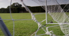 Football hitting back of the net. Shot on RED Epic. Stock Footage