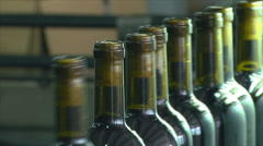 Wine bottles getting processes in factory Stock Footage