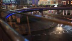Time laspe of People walking on round pedestrian bridge in Shanghai Stock Footage