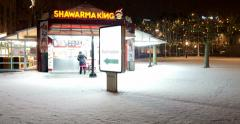 Woman passing in front of Shawarma King kiosk Stock Footage