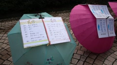 "Personal advertisements on umbrellas of ""Marriage Market"" at People's square - stock footage"