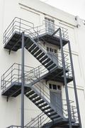 Stock Photo of Grey fire escape on white building