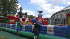 parents look after children in inflatable playground. 4K - stock footage