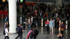 Crowds of people scanning subway pass at the ticket gate in Shanghai Stock Footage
