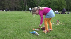 Girl catch toy fishes with artificial rod. 4K Stock Footage