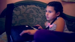 teen girl playing laptop  lying on the sofa internet search computer game - stock footage