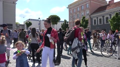 People enjoy bubble blow in main city square. 4K Stock Footage