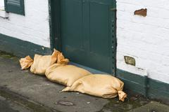 Sandbags at the door for flood protection Stock Photos