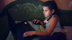 girl teen playing  laptop  lying on the sofa internet search computer game - stock footage