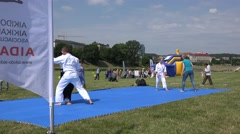 Stock Video Footage of aikido master of martial arts teach followers in front of audience. 4K