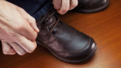 Man laces his shoes Stock Footage