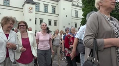 Christian citizen people participate in sunday religious procession. 4K Stock Footage
