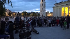 Stock Video Footage of street musicians men play music for tourists and citizens at night. 4K