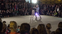 Citizen people audience enjoy boy and girl performing modern dance. 4K Stock Footage