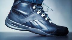 A man walks in the shoes in slow motion. Closeup. Shallow depth of field Stock Footage