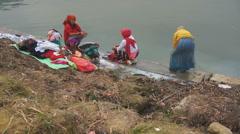 Local women doing laundry, Pokhara, Nepal Stock Footage