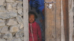 Local children in the village of Jomsom, Annapurna Conservation Area, Nepal Stock Footage