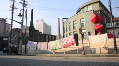 A dog watching over laundries around 1933 laochangfang street in Shanghai Stock Footage