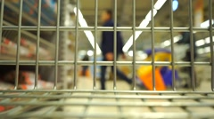 Stock Video Footage of View from supermarket cart. Slow motion video with blurred background