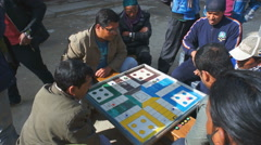 Street scene with local people playing a board game, Baglung, Nepal. Stock Footage