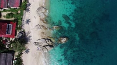 Flight above beautiful beach in thailand, Aerial veiw on volcanic rock. Stock Footage