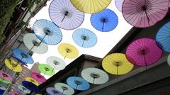 Tilt down shot of beautiful umbrellas at Tianzifang in Shanghai, China Stock Footage