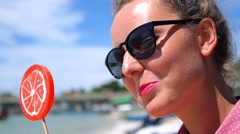 Coquette Woman with Colorful Lollipop Outdoors Stock Footage