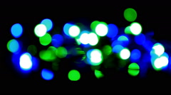 Christmas and new year decoration. Abstract blurred bokeh blinking garland Stock Footage