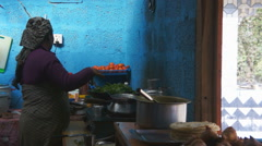 Local woman cooking in the kitchen, Pokhara, Nepal. Stock Footage