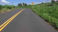 4K Driving POV Road Curves Cuts Through Green Landscape To Scenic Pull-Off Stock Footage