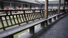 Tourists sitting and resting on the bench in Wuzhen Stock Footage