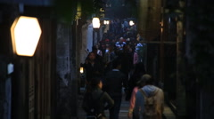 Tourists walking on the narrow street of Wuzhen, water town at night Stock Footage