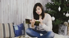 Girl writing a gifts list. Female wearing jeans and a white jacket Stock Footage