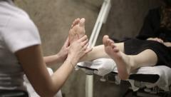 Foot massage at the spa Stock Footage