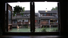 View from the window of traditional chinese houses by canal in Wuzhen Stock Footage