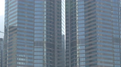 Skyscrapers in Hong Kong, tilting shot. Flat picture profile. Stock Footage