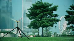 Automatic sprinkler watering in the park, Hong Kong. - stock footage