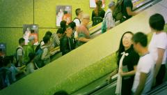 Commuters on Escalators in Subway, Hong Kong. Speed-lapse. Color graded. - stock footage