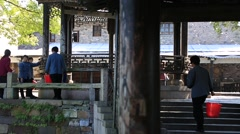 Workers working around old water town in Wuzhen, China Stock Footage