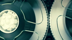 Rotation reels with tape on the video, audio tape recorder / player. Macro - stock footage