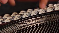 Typing on vintage typewriter (1930s-1960s) - stock footage