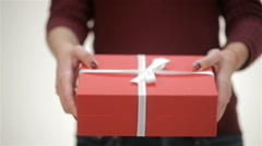 Close up a girl gives a gift - stock footage