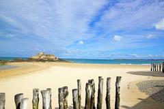 Saint-Malo, the beach in low tide and the national fort (Brittany France) - stock photo