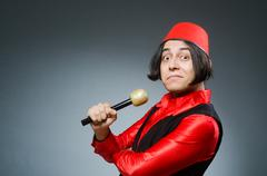 Man wearing red fez hat - stock photo