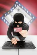 Stock Photo of Hacker with ID card in hand and USA states flag on background - Arkansas
