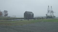 Salem, MA sailboat in harbor, port in rain establishing shot Stock Footage