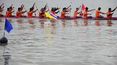 Thai people join with Long boat Racing at Chaopraya river Stock Footage