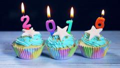 Cupcakes and candles Happy New Year Stock Footage