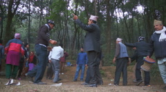 Local people dancing on the edge of the forest, Pokhara, Nepal. Stock Footage