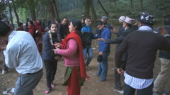 Local people dancing on the edge of the forest, Pokhara, Nepal. - stock footage